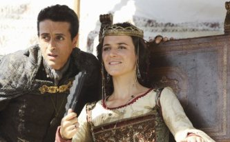 """ABC's The Quest: Fan beloved Marcello Denardo as The Grand Vizier and Susanne Gschwendtner as the charming Queen Ralia. """"He called me 'My Lady'?"""" Queen Ralia tells The Grand Vizier while watching a tournament of skill."""